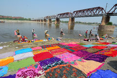 Many people washing clothes on the river Royalty Free Stock Image