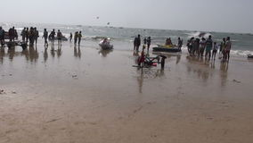 Many peoples on Arabian sea beautiful resort beach in Goa, Panaji. GOA, INDIA, JANUARY 12, 2014: many peoples on Arabian sea beautiful resort beach in Goa stock footage