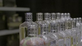 Many perfume bottles. In different sizes shapes stock video footage