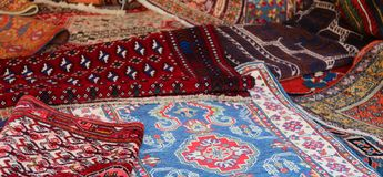 Many persian and oriental rugs. Background of many persian and oriental rugs stock photography