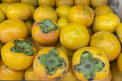 Many persimmon fruits and delicious.  Royalty Free Stock Images