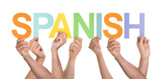 Many Persons Holding The Word Spanish Stock Photo