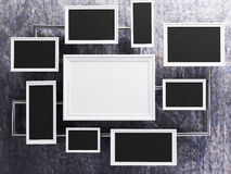 Many pictures on the gray wall. Rendering Royalty Free Stock Image