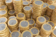 Many piles of one Euro coins Stock Photo
