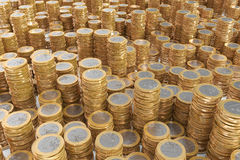 Many piles of one Euro coins Stock Images