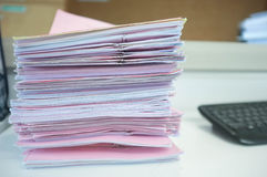 Many piles of papers on the desk Royalty Free Stock Photo