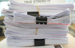 Many piles of papers on the desk Stock Photos