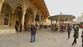 Many pilgrims to the mausoleum tombs of the great Sufi Rumi in the center of the Turkish city of Konya. KONYA / TURKEY - 11.20.2016 central streets of the stock footage