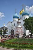 Many pilgrims and tourists gathered in the main square of the Cathedral of the Holy Trinity St. Sergius Lavra. Royalty Free Stock Image
