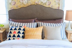 Many pillows on the bed and the bed head lamps. Royalty Free Stock Photography
