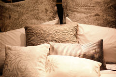 Many pillows on the bed Stock Images