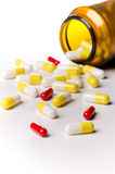 Pills lie before medication canister Stock Image