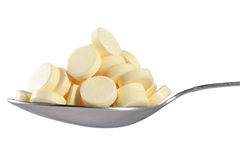 Many pills in spoon Royalty Free Stock Photography