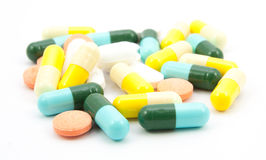 Many pills and tablets isolated Royalty Free Stock Photos