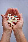 Many pills on two hands Royalty Free Stock Images