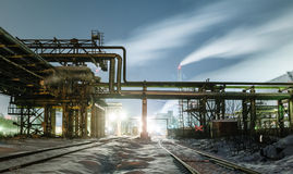 Many pipes and smokestacks with industrial tower Royalty Free Stock Photography