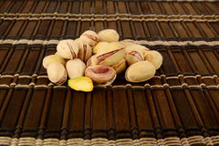 Many pistachios on brown mat Stock Photography