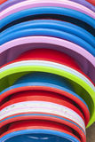 Plastic basins in many colors. Many plastic basins in different colors, as a stack on a open market, under sunlight Stock Photo