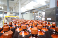 Many plastic bottles with beer and cap Royalty Free Stock Image