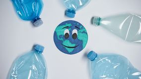 Many plastic bottles polluting earth, harm of extra litter, ecological problem