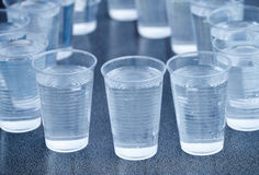 Many plastic cup isolated on gray. Background royalty free stock photos