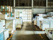 Many plastic packaging of paper in a large warehouse. Many plastic packaging of paper in a large warehouse paper factory Stock Image