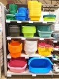 Many plastic products wash bowls on shelf store. Many plastic products wash bowls on the shelf store stock photography