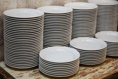 Stacks of plates on the table in the restaurant stock photography