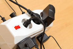 Many plugs in a power strip Stock Photo