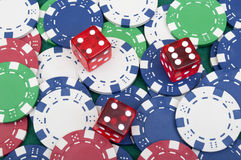Many poker chips and dice Royalty Free Stock Image