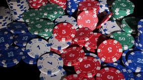 Many poker chips falling on a black background. 2 Royalty Free Stock Photo
