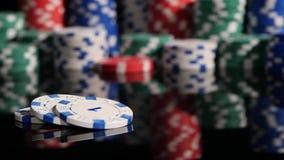 Many poker chips falling on a black background. 2 Stock Photo
