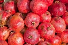 Many pomegranates. A lot of red garnets Stock Photo