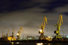 Many port crane in wintertime at night, Saint - Petersburg, Russia Stock Photo