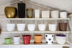 Many pots in different shapes and sizes lined up royalty free stock photography