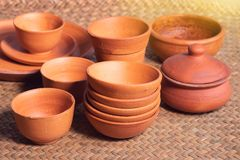 Many pottery bowl of various styles in the store. Many pottery bowl of various styles put on the mat in the store stock photography