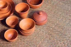 Many pottery bowl of various styles in the store. Many pottery bowl of various styles put on the mat in the store stock photo