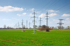 Many power tensions and lines on the field Stock Photo