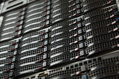Many powerful servers running in the data center server room. Server rack cluster in a data center Stock Photography