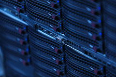 Many powerful servers running in the data center server room. Server rack cluster in a data center Royalty Free Stock Image