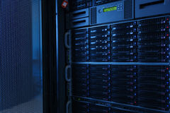 Many powerful servers running in the data center server room. Server rack cluster in a data center Royalty Free Stock Photos
