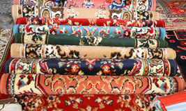 Many precious ancient colored wool rugs made by hand in Asia Royalty Free Stock Photography