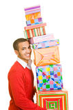Many presents. Man carrying a stack of presents royalty free stock images