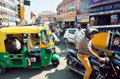 Many private yellow-green rickshaw cabs and cars on the street traffic jam in indian town Royalty Free Stock Image