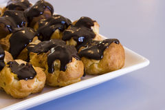 Many Profiteroles on a Plate Stock Photography