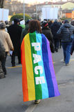 Many protesters in the demonstration with multicolored flag with Stock Image