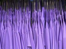 Many purple shirts of football players Stock Image