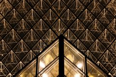 Louvre by night stock images