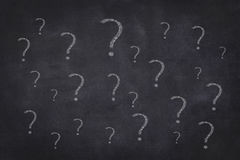 Many question marks - chalkboard background stock images