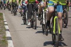 Many racing bikes. A group of cyclists riding during the street Stock Photo